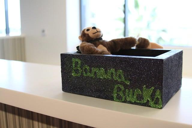 Tanga Mascot Bathing in Banana Bucks